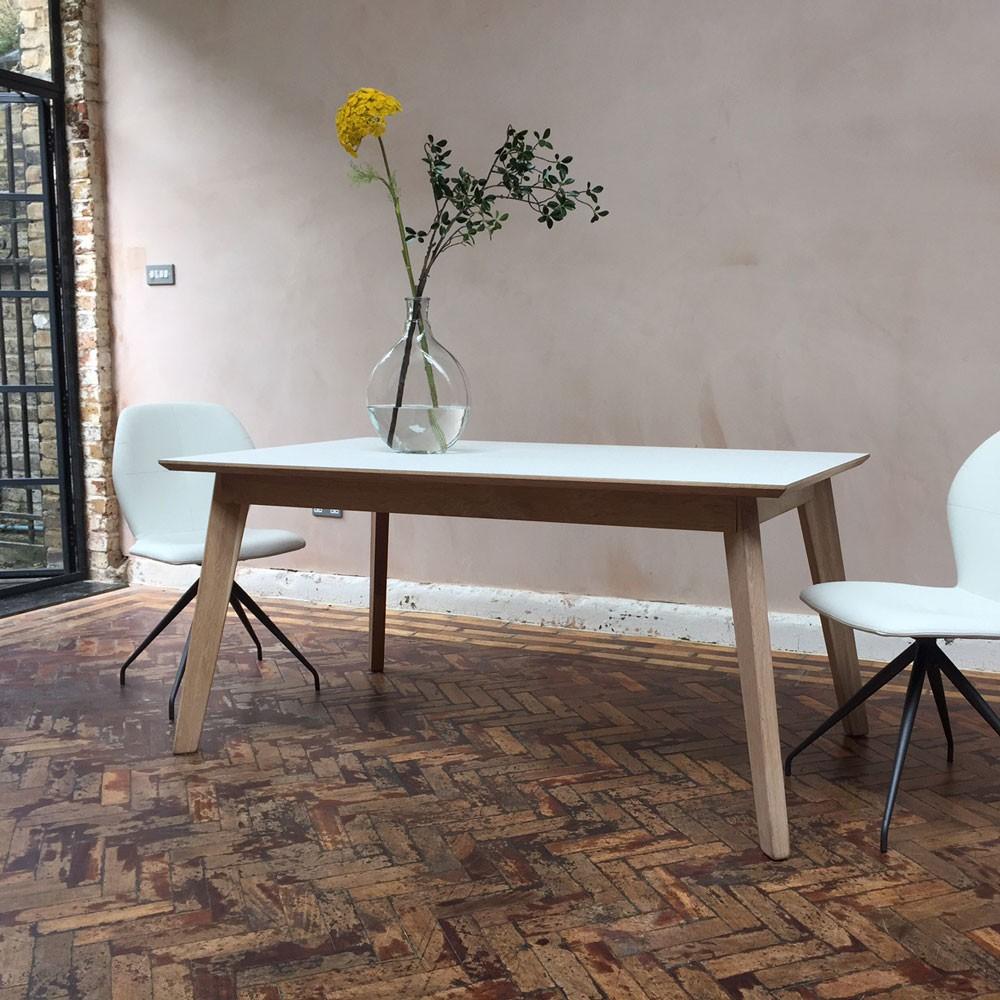 Bianco Fenix + walnut dining table