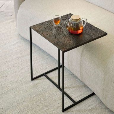 Lava coffee table is the table underneath, without the linear pattern