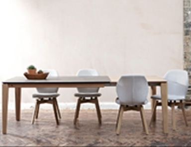Round Leg Ceramic Dining Table By Adventures In Furniture.