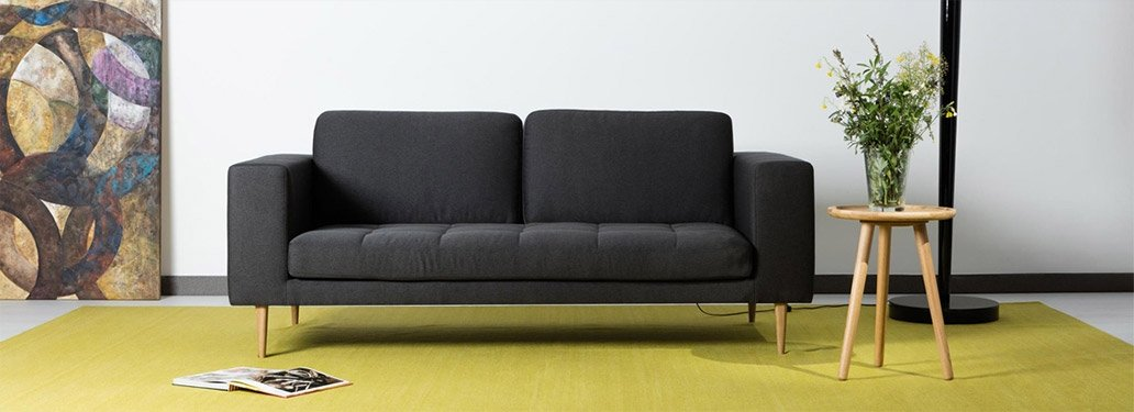 2 Seater Sofa Designed By Adventures In Furniture. This Dark Grey Sofa Has Endless Fabric Choices To Fit Every Space In Your Home. This grey sofa looks complete with a black coffee table
