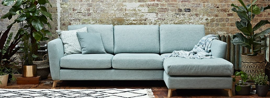 3 Seater Corner Sofa designed By Adventures In Furniture. This Turquoise Sofa Has Endless Fabric Choices To Fit Every Space In Your Home. The look is complete with our solid oak dining table