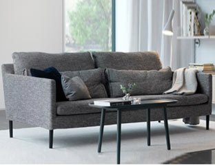 2 Seater Sofa Designed By Adventures In Furniture. This Grey Sofa Has Endless Fabric Choices To Fit Every Space In Your Home. This grey sofa looks complete with a black coffee table