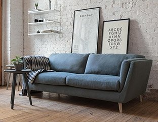 3 Seater Sofa designed By Adventures In Furniture. This Modern Sofa Has Endless Fabric Choices To Fit Every Space In Your Home. The look is complete with turquise pillows and a white rug