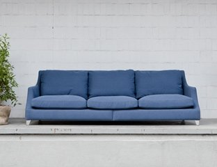 Grey 4 Seater Sofa designed By Adventures In Furniture. This Bespoke Sofa Has Endless Fabric Choices To Fit Every Space In Your Home. The modern sofa looks great on any flooring