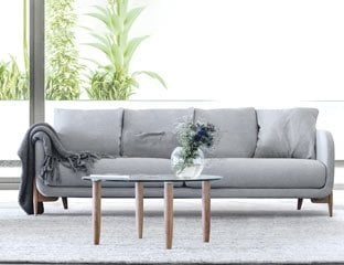 5 Seater Corner Sofa Designed By Adventures In Furniture. These Handmade Sofas Have Endless Fabric Choices To Fit Every Space In Your Home. This Sofa On Show Has Wooden Legs With A Matching Coffee Table