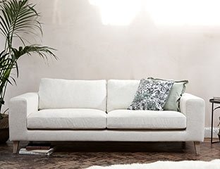 Cream 3 Seater Sofa Designed By Adventures In Furniture. This Modern 3 Seater Sofa Has Endless Fabric Choices To Fit Every Space In Your Home. The cream sofa on display looks complete with a lime cushions