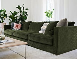 Green Fabric Sofa Designed By Adventures In Furniture. This Modern Fabric Sofa Has Endless Fabric Choices To Fit Every Space In Your Home. This sofa looks amazing in a white themed room or with our modern coffee tables