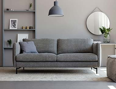 Grey 3 Seater Sofa designed By Adventures In Furniture. This 3 Seater Fabric Sofa Has Endless Fabric Choices To Fit Every Space In Your Home. This modern grey sofa looks great on any flooring