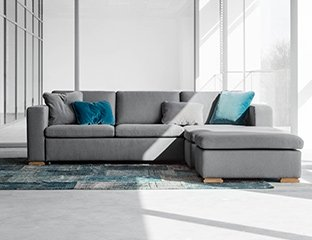 Grey Corner Sofa Bed Designed By Adventures In Furniture. This Modern Sofa Bed Has Endless Fabric Choices To Fit Every Space In Your Home. The cream sofa on display looks complete with a turquoise cushions