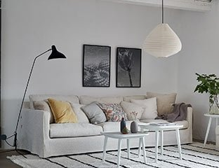 Light Grey Sofa Designed By Adventures In Furniture. These Handmade Sofas Have Endless Fabric Choices To Fit Every Space In Your Home. The Sofa On Show Looks Great With Patterned Cushains And A Matching Rug